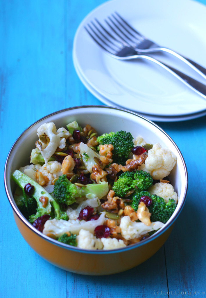 This broccoli cauliflower salad will have you merrily eating your veggies. It combines broccoli and cauliflower with smoked paprika flavoured walnuts and pepitas (pumpkin seeds), dried cranberries, and a savoury salad dressing - the result is a healthy fresh and crunchy salad. Click through for recipe. www.isleofflora.com
